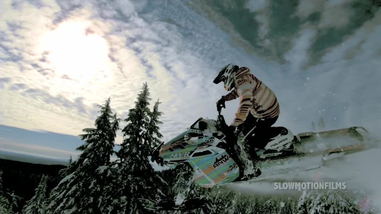 Snowmobiling in Super Slow Motion by SlowMotion Films  Background